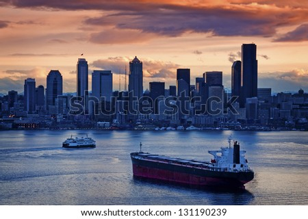 Seattle Sunrise Over Elliott Bay. A beautiful sunrise overlooking Elliott Bay and the Seattle Skyline. - stock photo