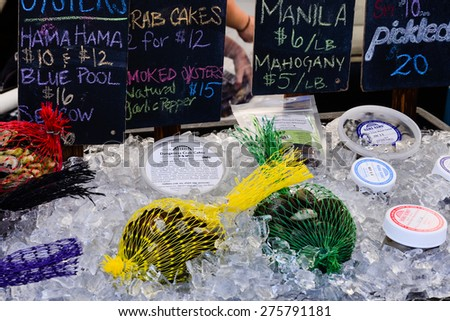 SEATTLE UNIVERSITY FARMER MARKET, WA, USA - MAY 2, 2015 - Fresh seafood at University District farmer market (aka U-district) in Seattle, WA, USA - stock photo