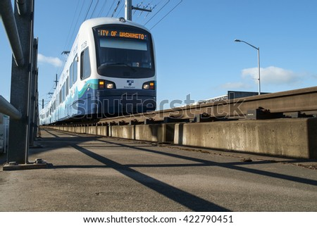 Seattle, USA April 09 2016 - Northbound Sound Transit Link lightrail train approaching SODO station from its origin at SeaTac airport