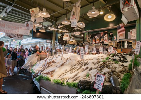 SEATTLE, USA - 18 JULY 2014: Famous Fish throwing at Pike Place Market - stock photo