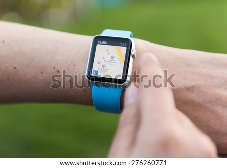 SEATTLE, USA - May 8, 2015: Man Using Maps App on Apple Watch While Outside.