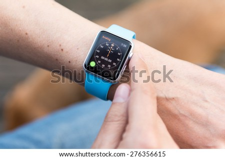 SEATTLE, USA - May 8, 2015: Man Using Stopwatch App on Apple Watch While Outside.