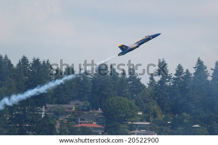 Seattle,WA-August 3: Navy Blue Angel #6 performing a rapid climb maneuver at the seafair over Lake Washington August 3, 2008