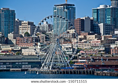 SEATTLE, WA - AUGUST 2:  Seattle Great Wheel reached its 1 million riders on August 2, just over 1 year after its opening, August 2, 2013 in Seattle, WA. - stock photo