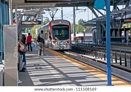 SEATTLE, WA - JULY 17:  The Link Light Rail public transit celebrated it 3rd successful year, with plans to increase its service area.  July 17, 2012 in Seattle, WA. - stock photo