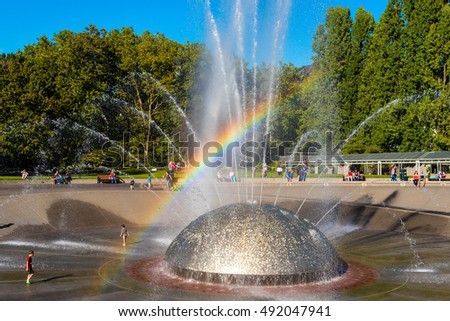 SEATTLE, WA - SEPTEMBER 10, 2016: The International Fountain in Seattle Center, built for the 1962 World's Fair, delights children and adults as the water syncs with music.