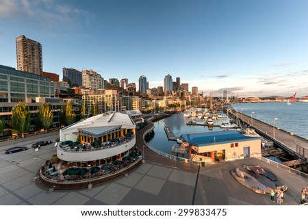 SEATTLE, WA, US - JULY 21, 2015 - Seattle Waterfront at Sunset with skylines, dense of boats on marina and ferries wheel. The Port of Seattle can be seen in the background local and tourism attraction - stock photo