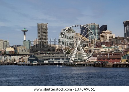 SEATTLE,WA,USA-APRIL17: The Seattle Great Wheel sets off the Seattle skyline on April 17,2013.  The Great Wheel is one of the Largest Ferris Wheels in the USA, built to attract tourists. - stock photo