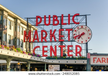 Seattle, WA. USA - July 7, 2014: Pike Place Market Neon Sign at sunset. Pike Place Market is a farmers market that was founded in 1907 to provide a place for customers to meet directly the producers.