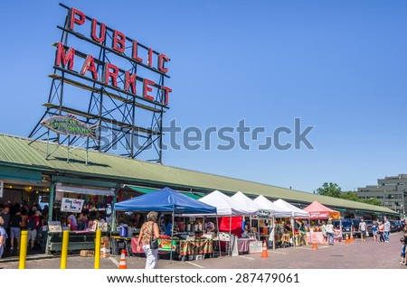 Seattle, WA, USA - July 8, 2014: Pike Place Market on a Clear Summer Day. Pike Place Market is a farmers market that was founded in 1907 to provide a place for customers to meet directly the producers - stock photo