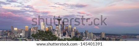 Seattle Washington City Downtown Skyline with Puget Sound and Mount Rainier at Sunset Panorama - stock photo