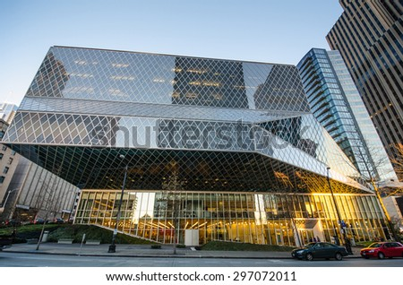 SEATTLE, WASHINGTON - JANUARY 4, 2014: View of the award-winning geometric glass and steel design of the Seattle Central Library from 4th Avenue as the sun sets.