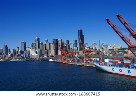 SEATTLE WASHINGTON 27 JUN 2008 -  Container ship and dockyard cranes, Seattle waterfront Puget Sound,  Pacific Northwest - stock photo