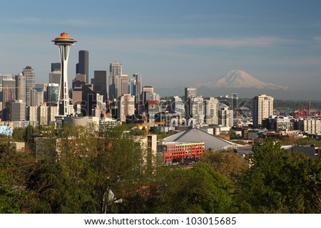 Seattle, Washington skyline near sundown. The landmark Space Needle with Mt. Rainier in the background stand out. - stock photo