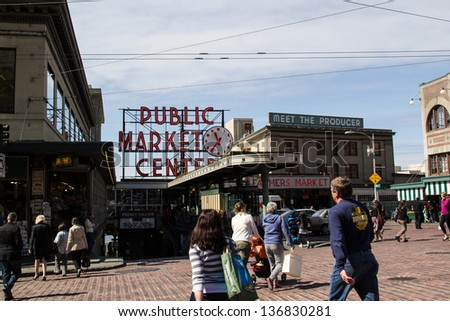 SEATTLE,WASHINGTON,USA-APRIL 17: People stroll in front of Seattle's Pike Place Market on April 17, 2013. Pike Place is one of the oldest continually operating farmers' markets in the US. - stock photo