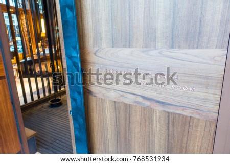 SEATTLE, WASHINGTON/USA   JUNE, 2017: Front Door Sign On Wood Sliding