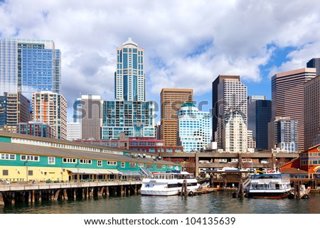 Seattle waterfront and skyline.  Close view from water.   Colorful and detailed. - stock photo