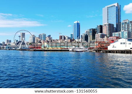 Seattle waterfront Pier 55 and 54. Downtown view from ferry. - stock photo
