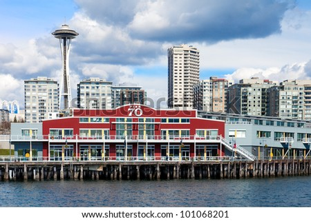 Seattle waterfront with Pier 70 and the Space Needle in the background, as viewed from Elliot Bay - stock photo