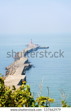 Seawall and lighthouse in in Kaohsiung, Taiwan.  - stock photo