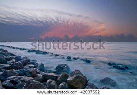 Seawall Dawn - stock photo