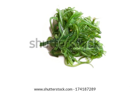 Seaweed salad with sesame seeds isloated on whitem veiw from the top - stock photo