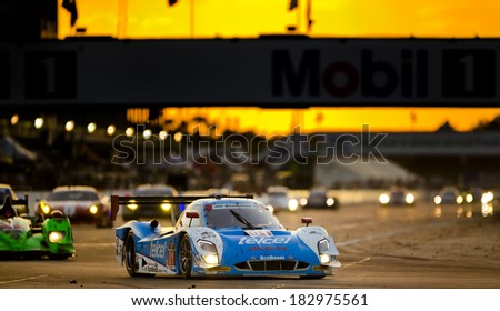 Sebring, FL - Mar 15, 2014:  The Telcel Ford EcoBoost travels through turn one at sunset during the 12 Hours of Sebring at Sebring International Raceway in Sebring, FL. - stock photo