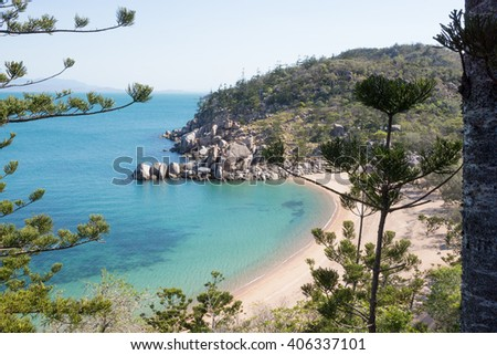 Secluded beach on tropical island from high view point - stock photo