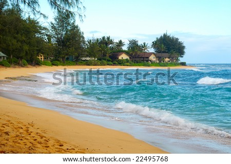 Secluded crescent beach with condos on the north shore of Kauai, Hawaii
