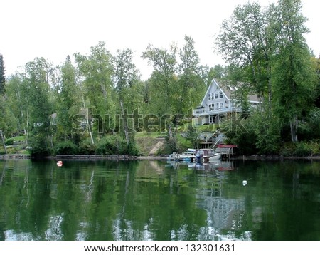 Secluded lake house scenic - stock photo