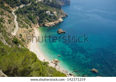 Secluded Mediterranean beach around Cabo de la Nao, Costa Blanca, Spain - stock photo