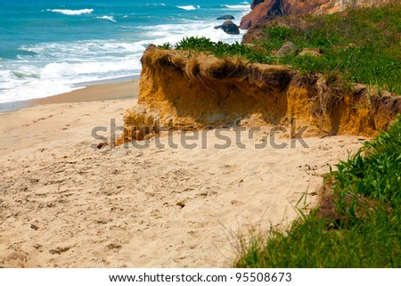 Secluded private beach with turquoise water on a sunny day - stock photo