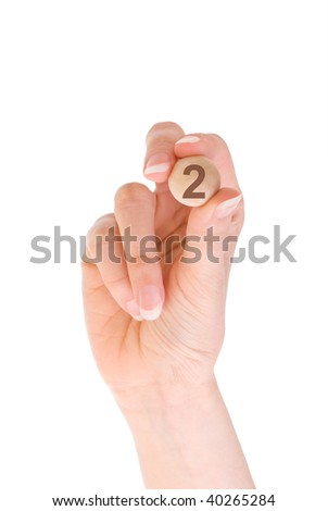 second bingo ball in the hand - stock photo