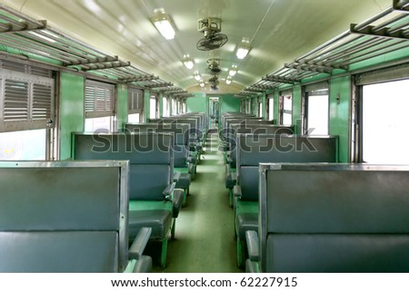 Second class soft seat passenger wagon train - stock photo