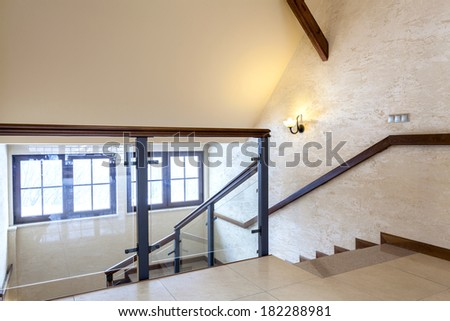 Second floor of modern building, glass banister - stock photo