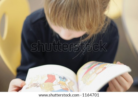 Second grade student reading - stock photo