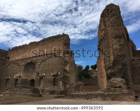 Second largest Roman public bath house at Caracalla in Rome, Italy.  Blue sky with wispy clouds on a hot summer day.