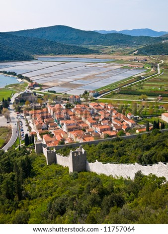 Second longest world walls. Ston small town near Dubrovnik, Croatia landscape in wide shot from top of the hill fortress. - stock photo