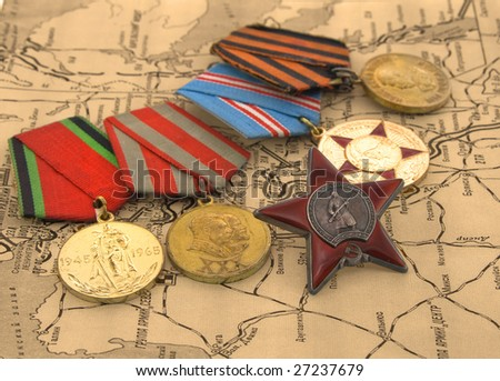 Second World War medals on a map - stock photo