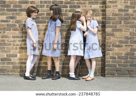 Secondary School Students in Playground - stock photo