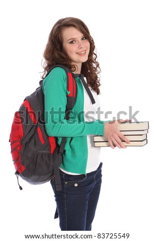 Secondary school teenager girl holding education books, with long brown hair wearing green jumper and red school backpack with big happy smile. Studio shot against white background.