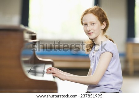 Secondary Student Practicing Piano - stock photo