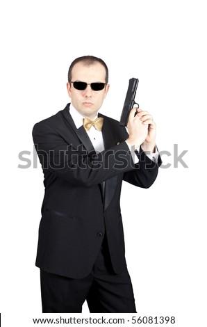 Secret Agent holding gun prepared to shoot. - stock photo