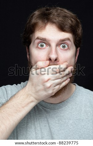 Secret concept - young man amazed by gossip news - stock photo