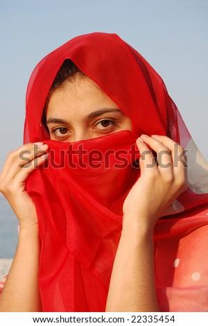 secret smile arabian girl - stock photo