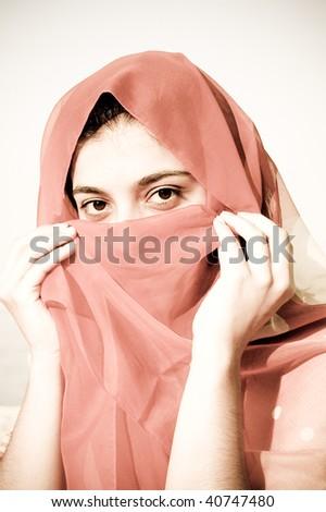 Secret smile arabian girl. Photo in retro style. - stock photo