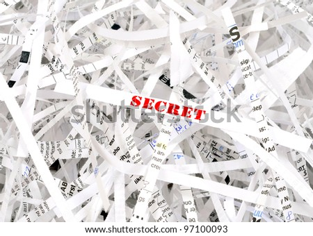 Secret text surrounded by shredded paper. Great concept for information protection - stock photo