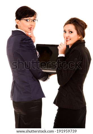 secret, two young business women with laptop, white background - stock photo