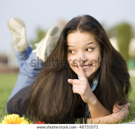 Secret. Woman at the summer park - stock photo