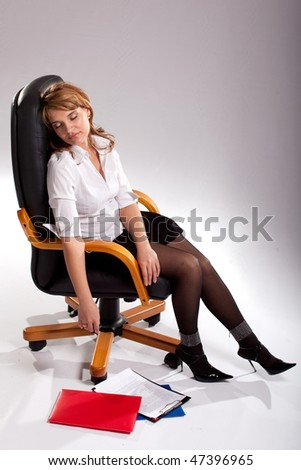 Secretary of the Weary girl asleep in his chair. - stock photo